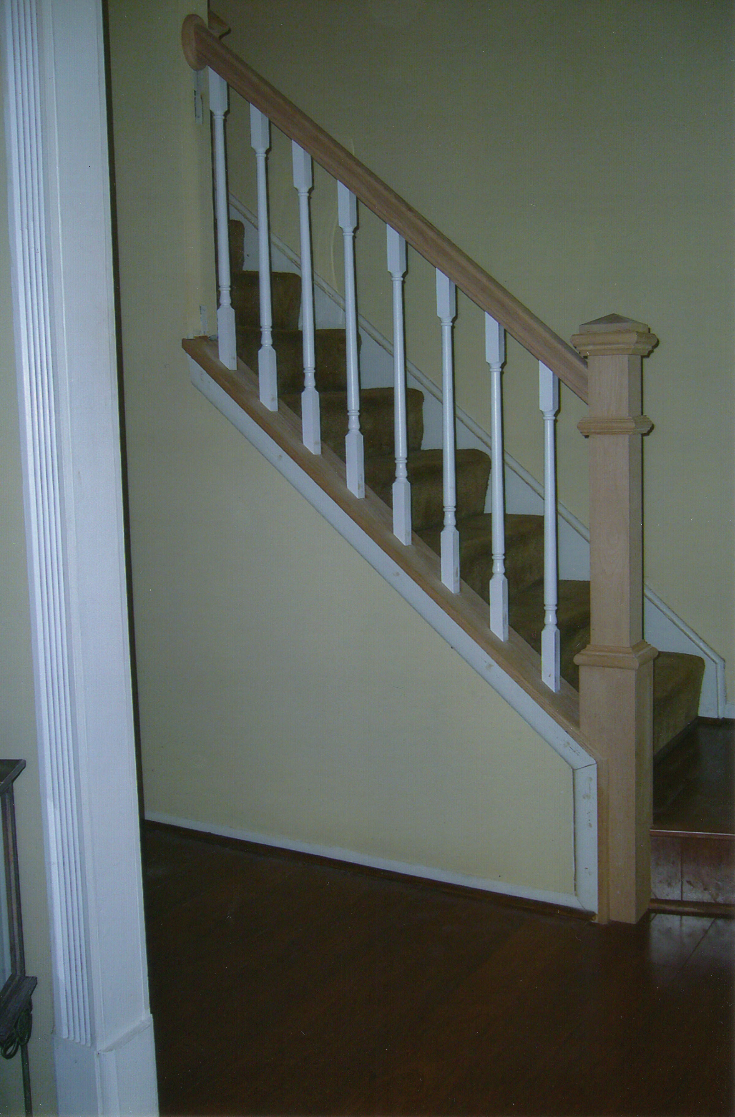 ... Wood Unstained Staircase And Newel Post, Railing With White Balusters  ...